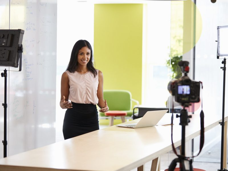 Young woman making a corporate demonstration video